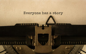 Typewriter with the typed words 'Everyone has a story'