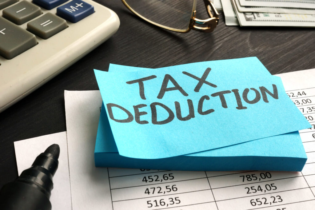 post it with the words tax deduction